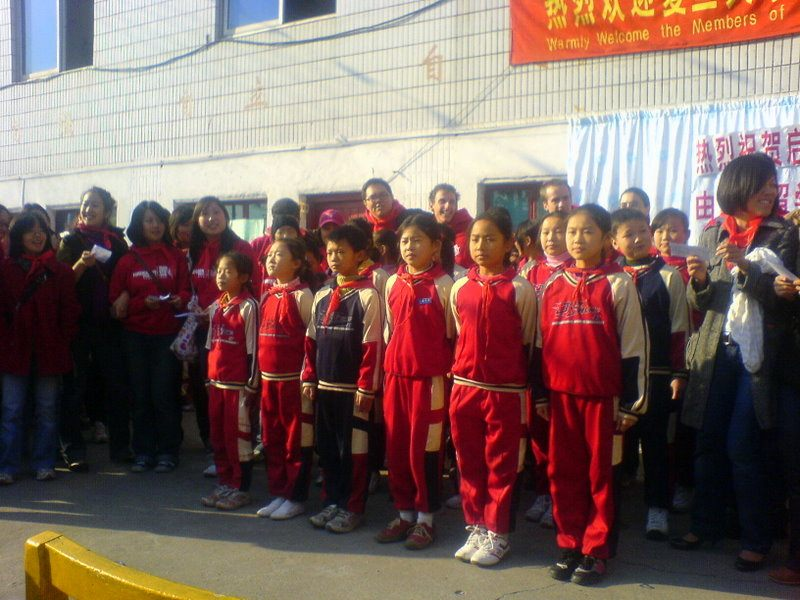Monica's students in rural China, standing at attention