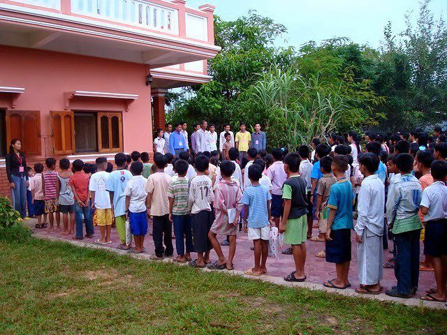 Students in Cambodia lining up to sing the National Anthem