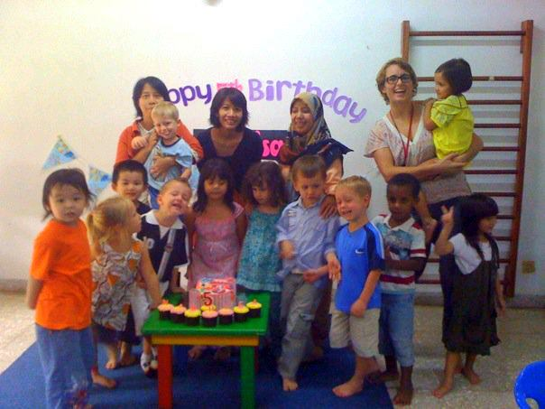 Treen and her students in Indonesia, celebrating a birthday.