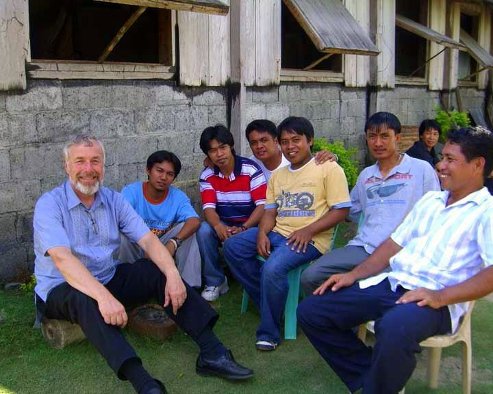 Bill in with students in a remote part of the Philippines.
