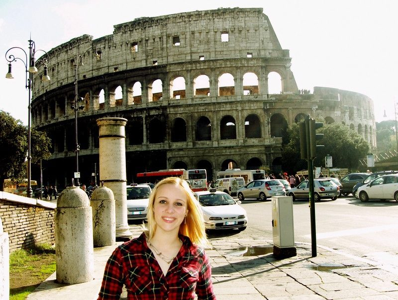 Kelly in Rome in 2010, sun glowing through the Colosseum.