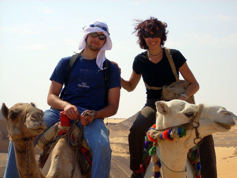 Holly and Chris riding camels in Egypt.