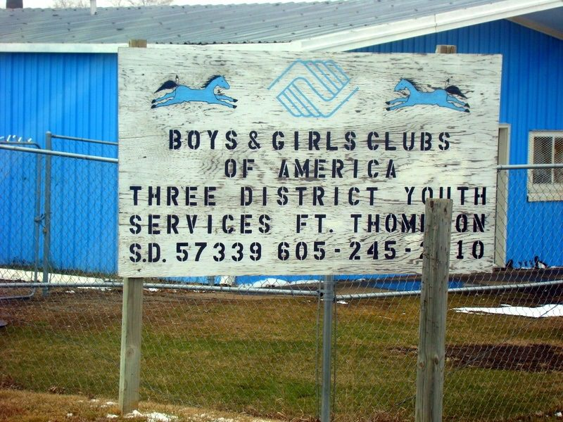 Boys and Girls club sign in Fort Thomspon, on the rez.