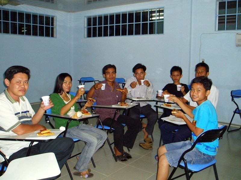 A class pizza party in Cambodia to coincide with a lesson about pizza in May 2006. For some of Nikki's students, this was the first time eating pizza.