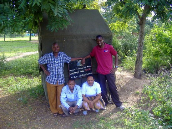 The SIC testing team in front of the counseling tent in Kisangaji village, Mwada.