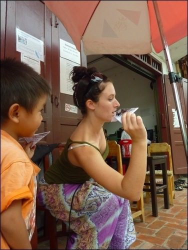 Teaching How To Make A Paper Airplane In Laos.