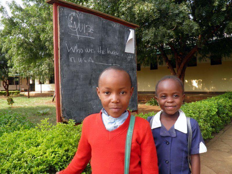 Children in Tanzania asking Francine a question.