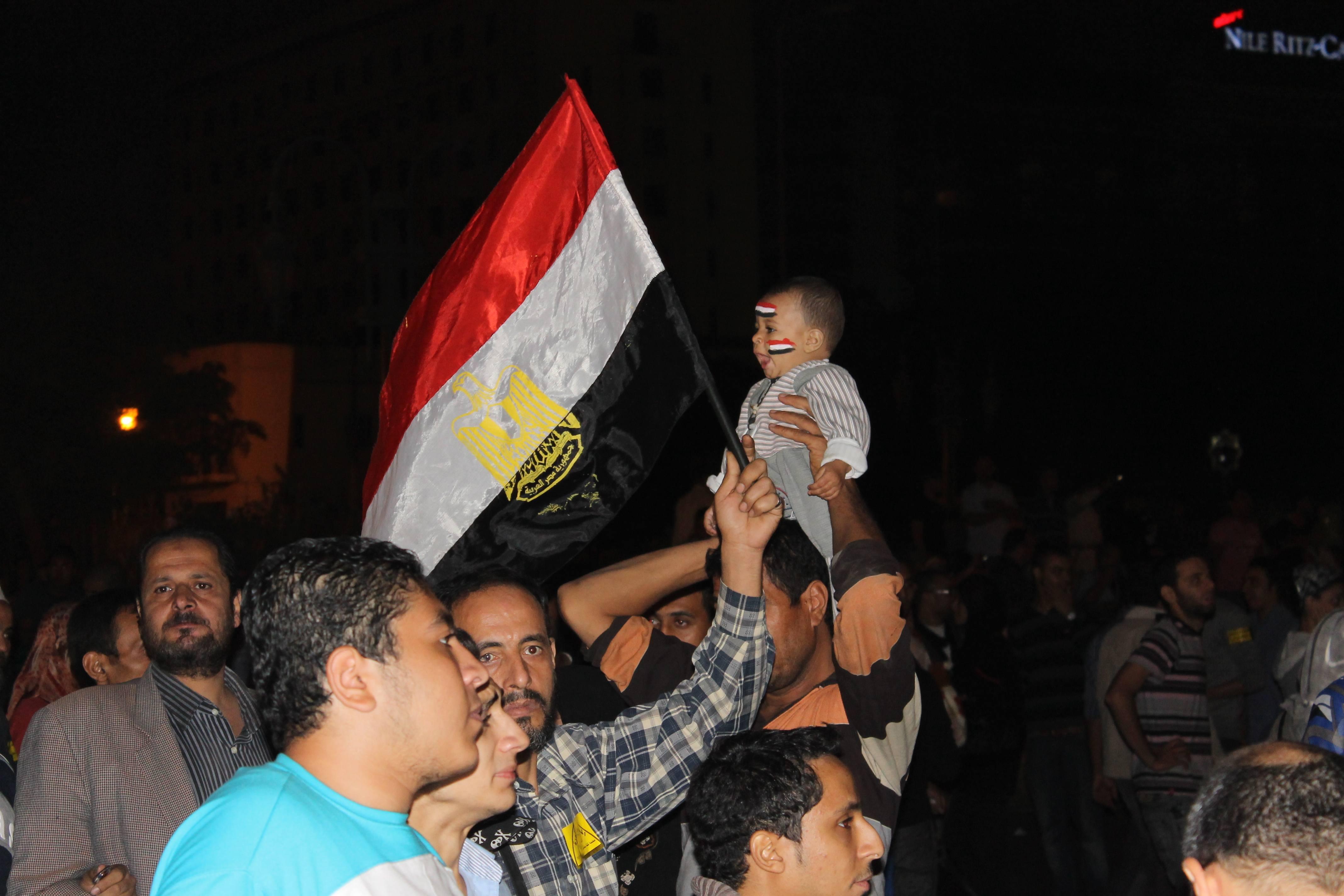 Demonstrators at Essam Atta's funeral in Cairo, Egypt.