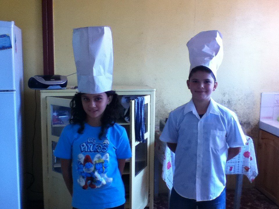 Fifth grade students creating a restaurant dialogue.