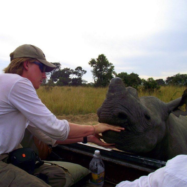 James feeding a Rhino in Zimbabwe. Wow!!!
