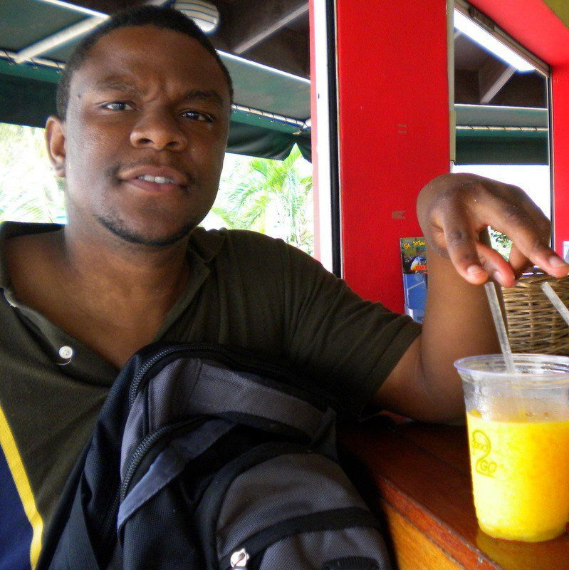 Winston in St. Maarten with a delicious juice.