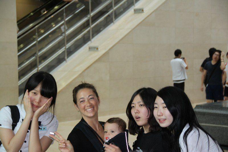 Stacey's son, Simon, with swarming teenage girls in Seoul, Korea, 2011!