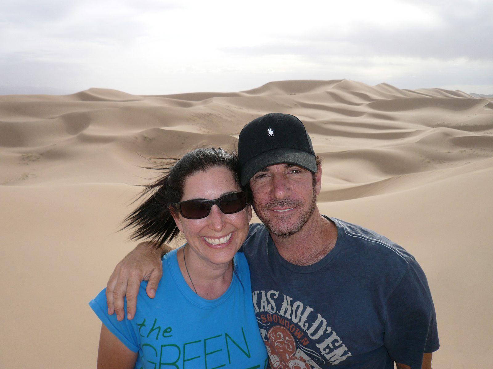 Lisa and George by exotic sand dunes during their travels.