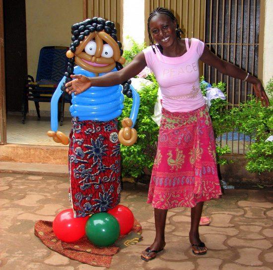 Balloon twisting full sized person in Mali