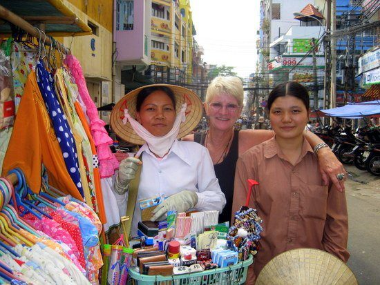With ladies at the bustling market of Ho Chi Minh City, Vietnam.