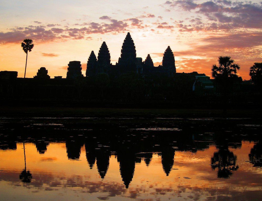 Catching the sunrise in world-famous Angkor Wat, Cambodia.