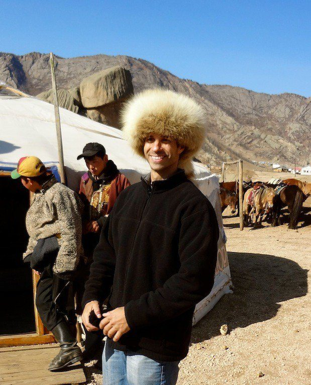 Sporting a very cool hat while traveling in Mongolia.