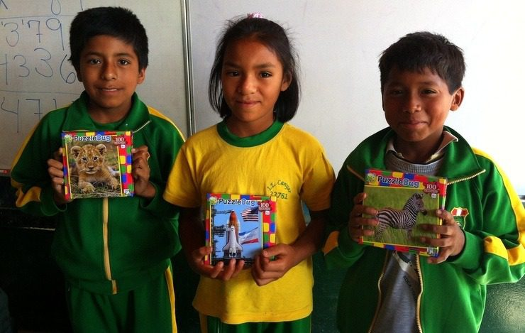 Students in Peru proudly showing their projects!
