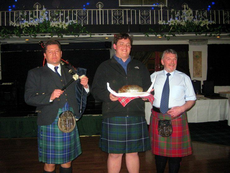 Presentation of Haggis at the Scottish ceilidh by one of Gail's students.