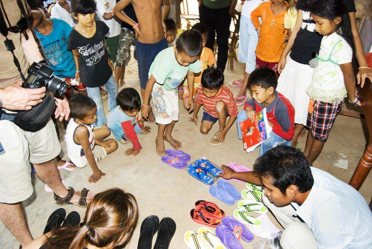 Donating sandals and clothes to an orphanage in Cambodia.