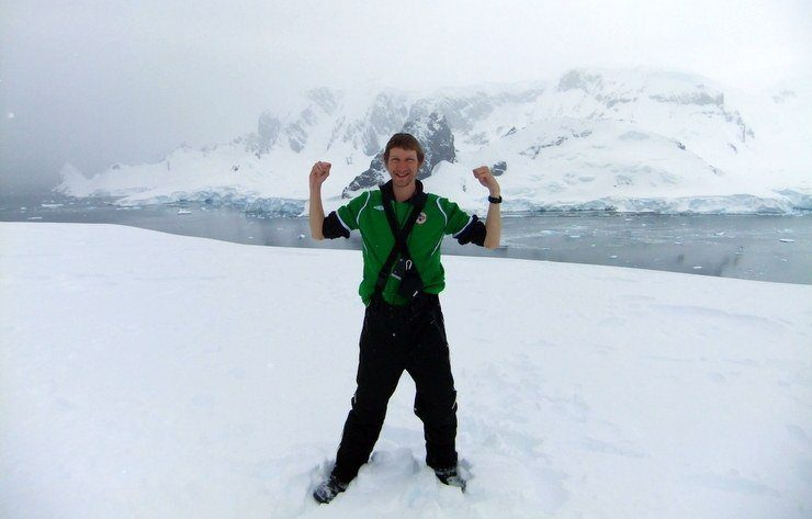 Jonny in Antarctica on the top of Cuverville Island.