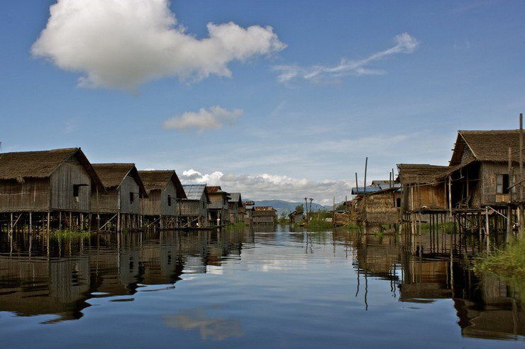 A typical yet surreal scene as one navigates the villages of Inle Lake.