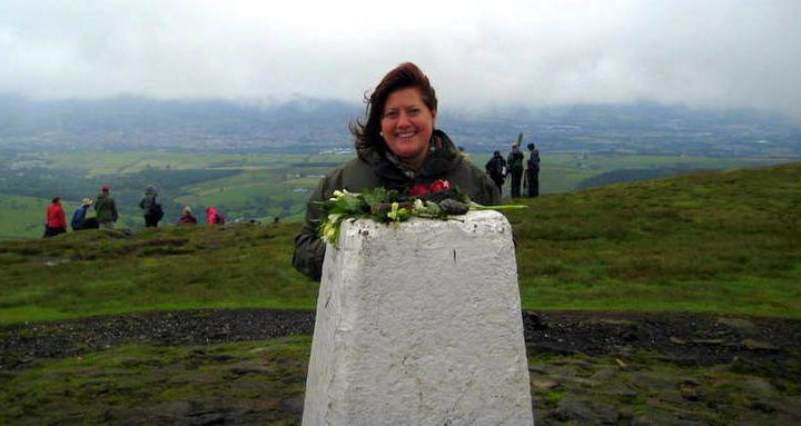 Alexandra at the top of Pendle Hill in England.