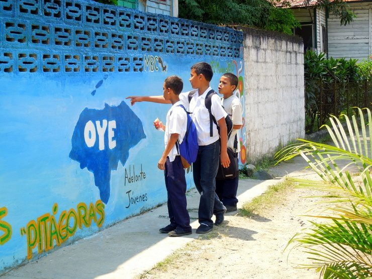 Students stop to admire the changes being made to the front of their school.