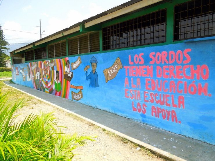 """The completed mural confidently states, """"The deaf have a right to education. Support this school."""""""