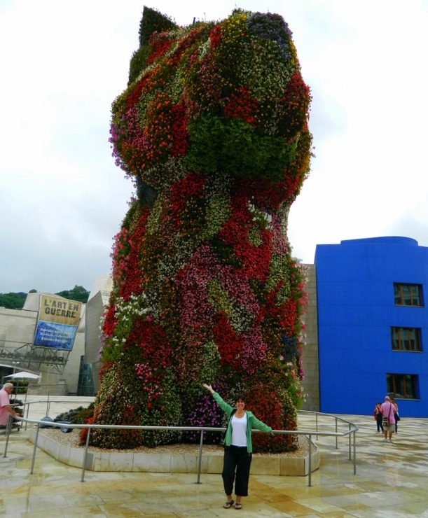 Jeff Koon's Puppy, a 43-foot flower topiary of a puppy standing guard at the front of the Guggenheim Museum in Bilbao, Spain.