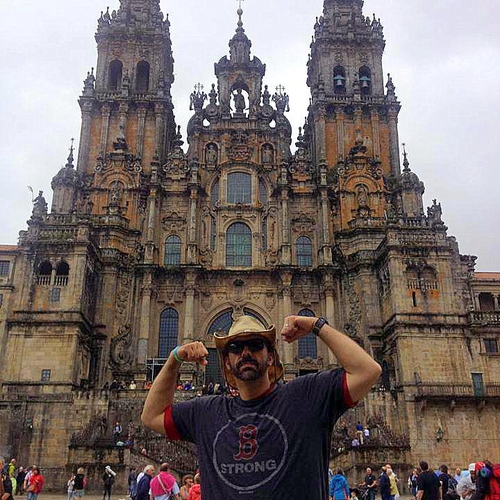 """Michael at the end of his Camino with his """"Boston Strong"""" shirt."""