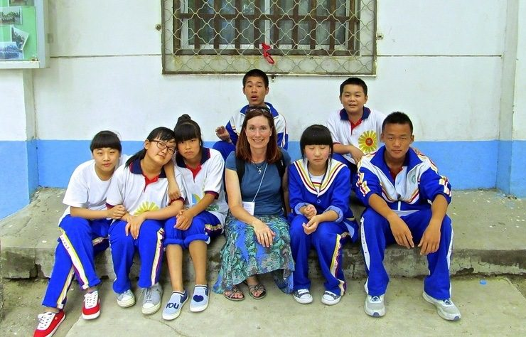 Students from Dandelion Middle School in Beijing, China pose with Arlis after a brief English lesson.