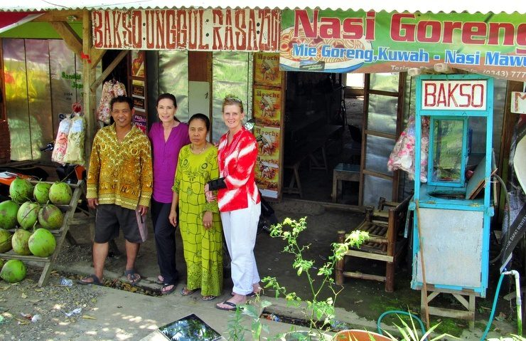 Arlis posing with the owners of a food stall that she frequented while staying at a madrasah in Mojokerto, Indonesia.