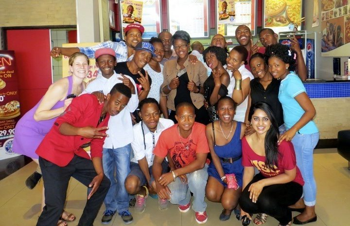 Mica with Club Empower students at their end of the year pizza party.