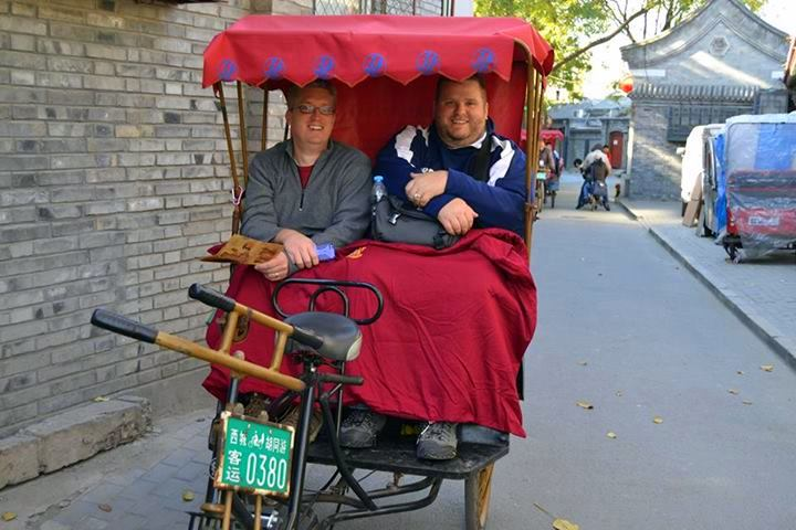 Mike with Nate Seelow, a traveling teacher from South Dakota, riding in a rickshaw in Beijing.