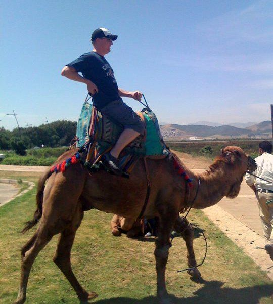 Mike riding a camel in Morocco.