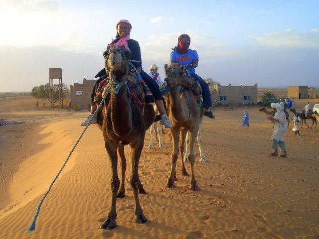 Reagan in Morocco with Agape Spiritual Center... learning to ride a camel!