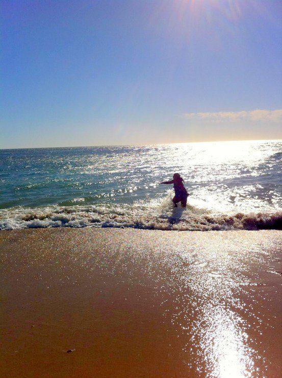 Frolicking in the ocean in Spain.