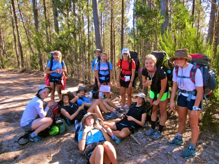 Resting with students during a long Odyssey hike through the bush.