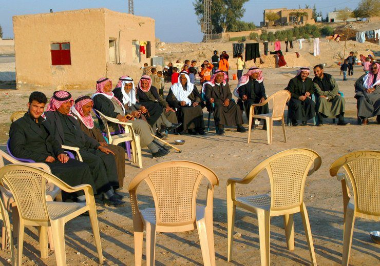 The men sit separately from the women at this family gathering during Holy Week in eastern Syria.