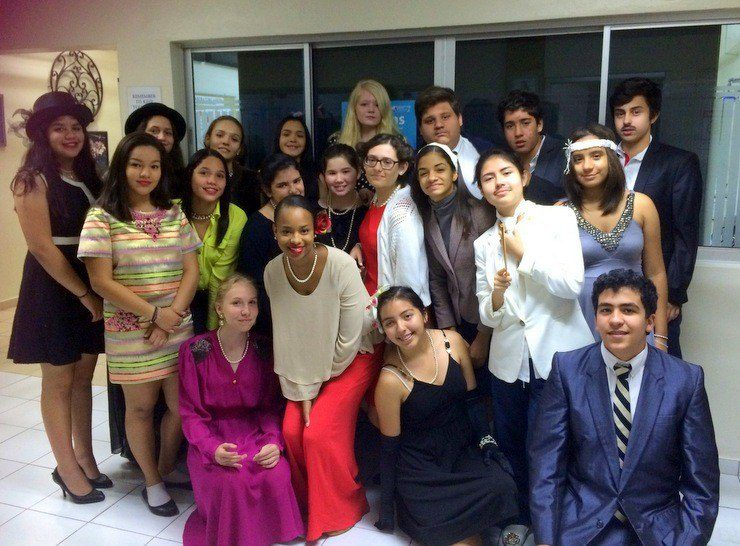 Jamilah's lovely, lovely students in the Dominican Republic. After studying the Harlem Renaissance, students performed original autobiographical poems while dressed as their Harlem Renaissance contributor. Jamilah is in the center.