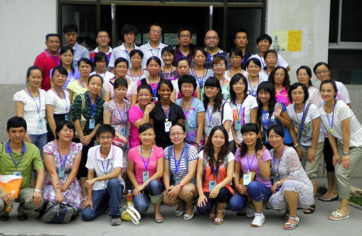 """Jamilah in the middle of her entire class of students in Beijing, China on """"picture"""" day."""