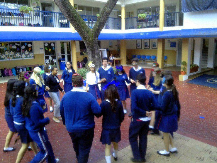 """Jamilah leading students in an Elizabethan Age style dance while students studied """"Romeo and Juliet."""" Great unit of study, great kids."""