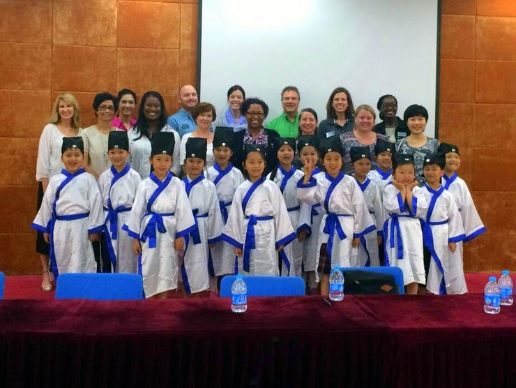 Candace and her colleagues with some of the sweet first graders from the Xu Guangqi Primary School in Shanghai, China.