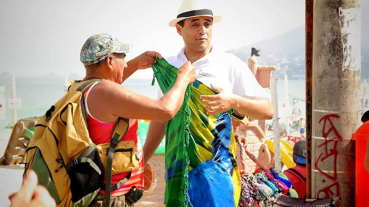 At Ipanema Beach, recording a video about fashion bikinis!