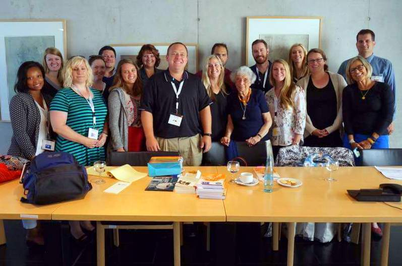 Karen with her study tour group in Germany, meeting a Holocaust survivor.