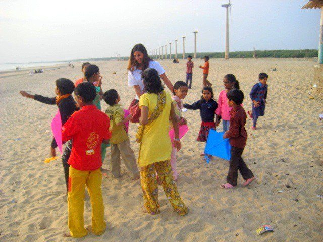 Andrea, flying kites and dancing in Mandvi, India.