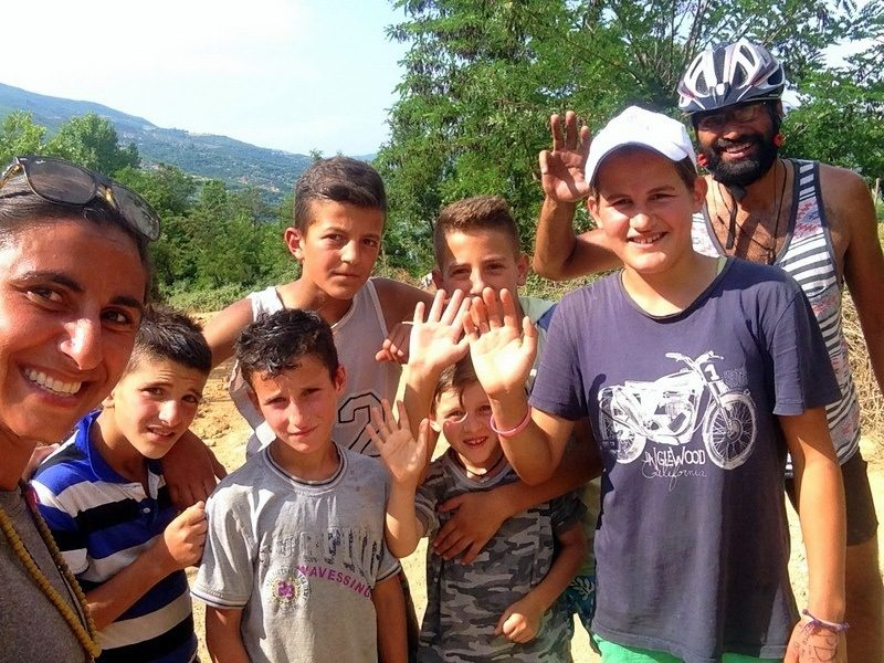 Andrea (left) in Albania, saved by a group of children who gave her water during a mountain hike.