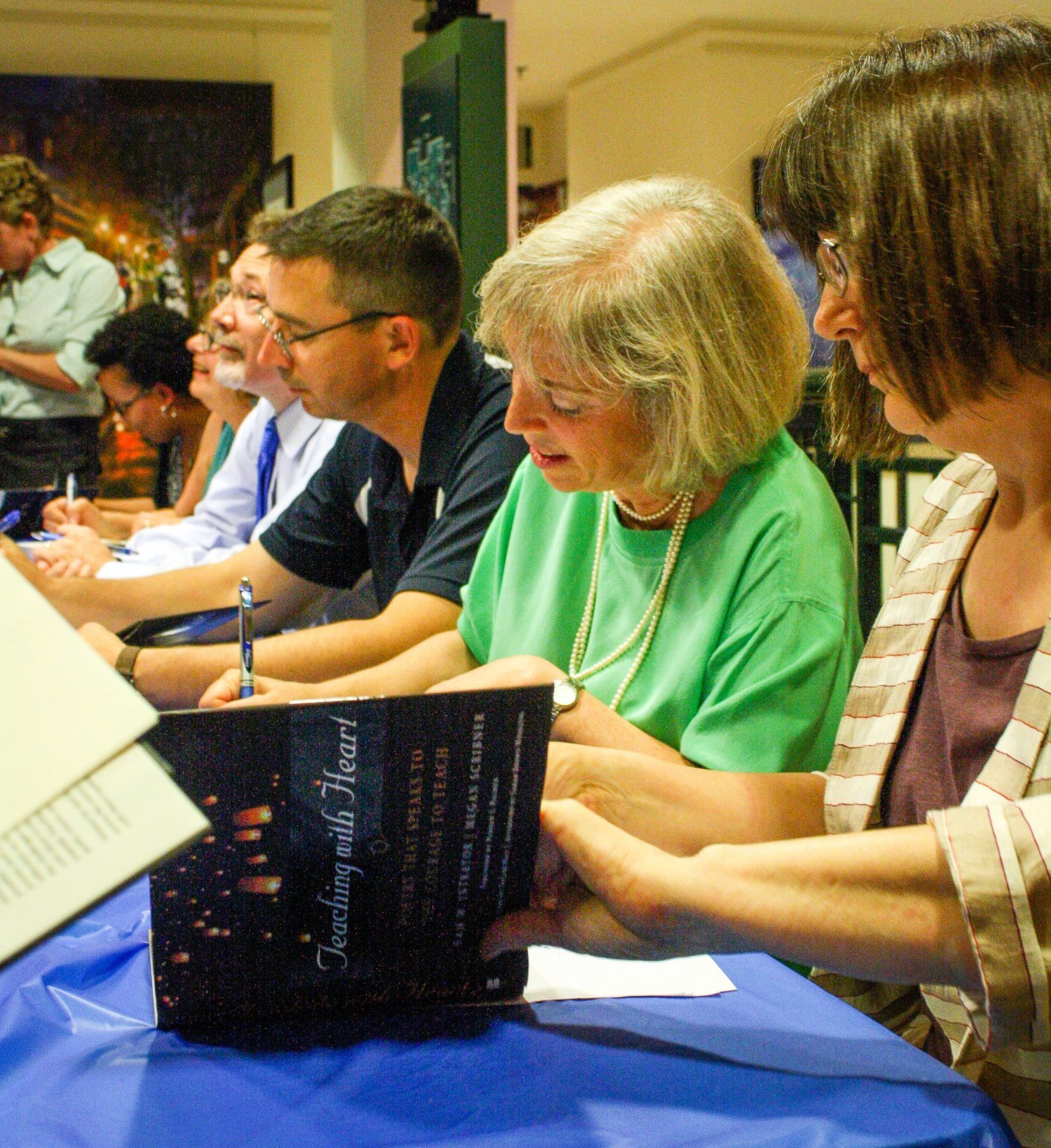 """""""Teaching with Heart"""" book reading, autographing the books: Megan Scribner, Christine Intagliata, Liam Corley, and Dennis Huffman in Maryland."""