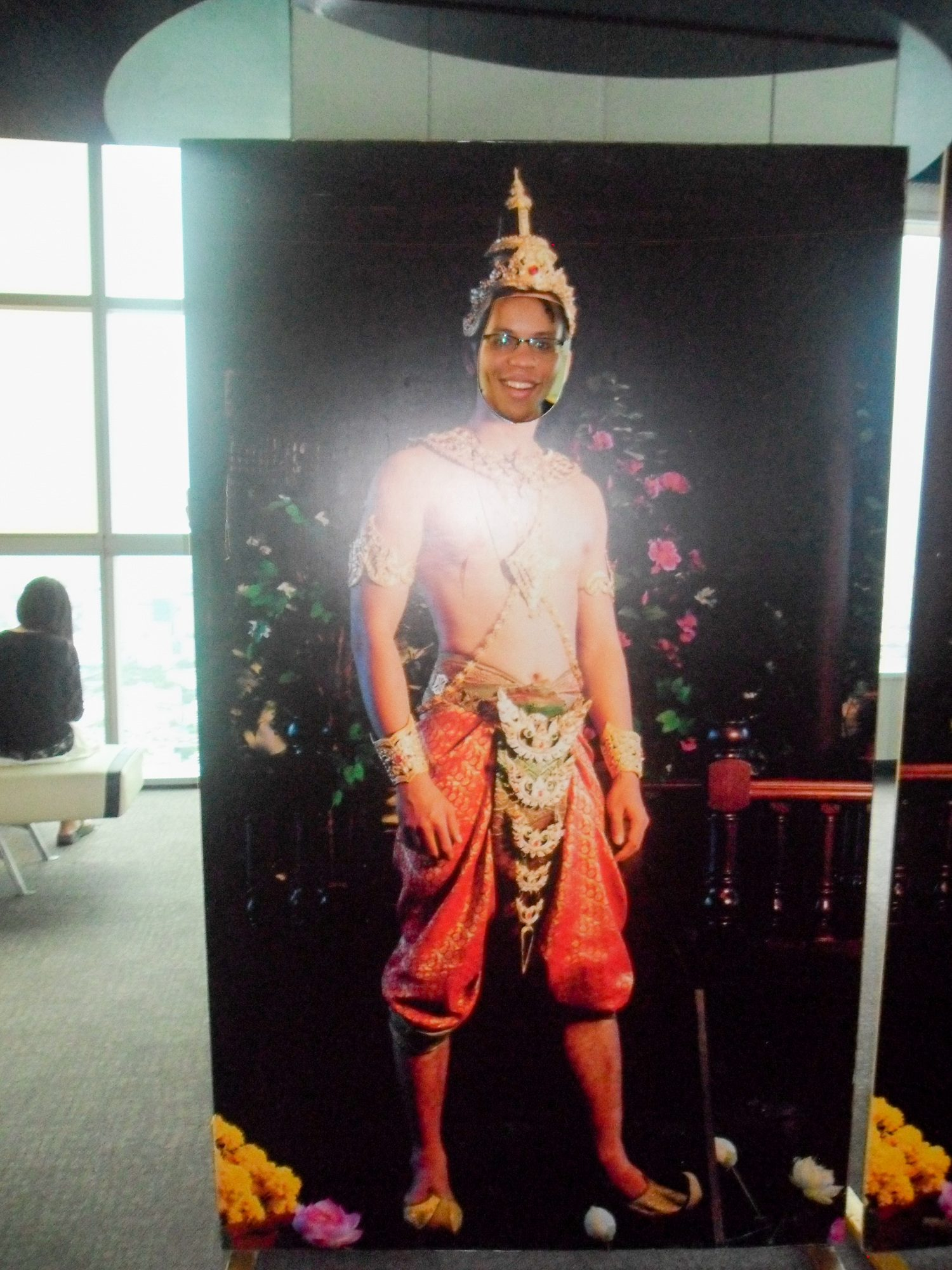 Visiting the tallest building in Thailand and posing behind this poster of traditional Thai dress.